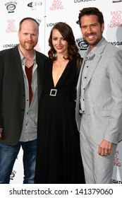 """LOS ANGELES - JUN 5:  Joss Whedon, Amy Acker, Alexis Denisof arrives at the """"Much Ado About Nothing"""" LA Premiere at the Oscars Outdoors at Academy Hollywood on June 5, 2013 in Los Angeles, CA"""