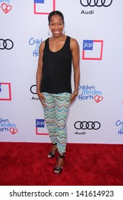 LOS ANGELES - JUN 8:  Regina King arrives at the 1st Annual Children Mending Hearts Style Sunday at the Private Residence on June 8, 2013 in Beverly Hills, CA