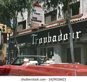 LOS ANGELES, June 13, 2019: Doug Weston's Troubadour nightclub West Hollywood exterior shot, with a classic red convertible parked in front, on Santa Monica Boulevard.