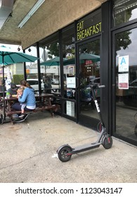 LOS ANGELES, JUNE 16, 2018: A Bird scooter stands abandoned on a sidewalk in front of a store in Culver City, California.