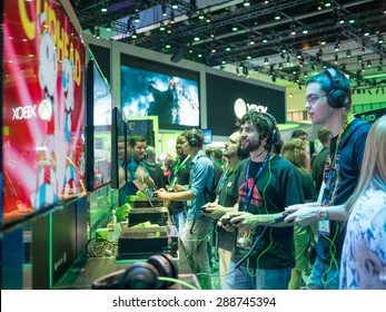 LOS ANGELES - June 16: Gamers playing demo XBOX games at E3 2015 expo. Electronic Entertainment Expo, commonly known as E3, is an annual trade fair for the video game industry