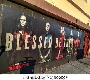 "LOS ANGELES - June 19, 2019:  Elizabeth Moss and the cast of ""The Handmaid's Tale"" appear on street posters in Hollywood that read ""Blessed Be The Fight""."