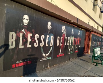 """LOS ANGELES - June 19, 2019:  Elizabeth Moss and the cast of """"The Handmaid's Tale"""" appear on street posters in Hollywood that read """"Blessed Be The Fight""""."""