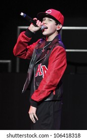 """LOS ANGELES - JUNE 24: You Tube sensation Austin Mahone, who the media has dubbed """"Baby Bieber,"""" sings in concert at The Wiltern Theater in Los Angeles, CA on June 24, 2012."""