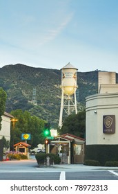 LOS ANGELES - JUNE 3:  Warner Bros. motion picture studio, Gate 4, on June 3,2011 located in Burbank, California.  The iconic studio remains an important tourist attraction in the Los Angeles area.
