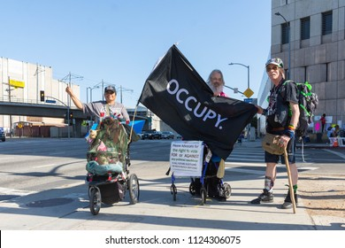 Los Angeles, June 30, 2018: Activists during The Families Belong Together march around the Metropolitan Detention Center in protest of President Donald Trump's zero tolerance immigration policy.