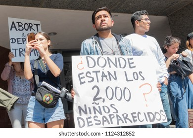 Los Angeles, June 30, 2018: An activist holds a sign during The Families Belong Together march around the Metropolitan Detention Center
