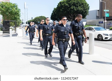Los Angeles, June 30, 2018: Police Officers during The Families Belong Together march around the Metropolitan Detention Center in protest of President Donald Trump's zero tolerance immigration policy.