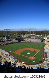 LOS ANGELES - JUNE 30: Classic view of Dodger Stadium before a sunny day baseball game on June 30, 2012 in Los Angeles, California. Dodger Stadium opened in 1962 and cost $23 million.