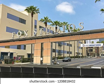 LOS ANGELES, JUNE 5TH, 2018: The Fox Studios logo and sign above the entrance to the 20th Century Fox Studios lot on Pico Boulevard and Motor Avenue in Century City, against a blue sky.