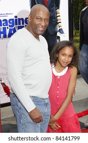 LOS ANGELES - JUNE 6: Director John Singleton and his daughter at the premiere of 'Imagine That' at Paramount Studios on June 6, 2009 in Los Angeles, California