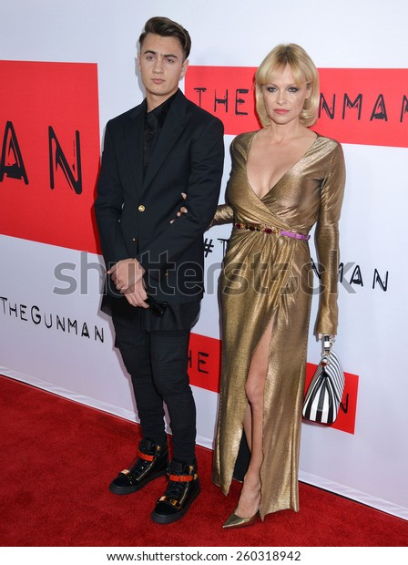"LOS ANGELES - MAR 12:  Brandon Thomas Lee, Pamela Anderson at the ""The Gunman"" Premiere at the Regal 14 Theaters on March 12, 2015 in Los Angeles, CA"