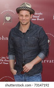 LOS ANGELES - MAR 13:  Justin Chambers arriving at the John Varvatos 8th Annual Stuart House Benefit at John Varvaots Store on March 13, 2011 in Los Angeles, CA