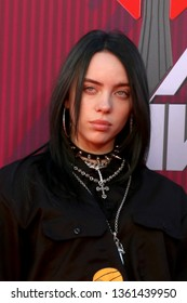 LOS ANGELES - MAR 14:  Billie Eilish at the iHeart Radio Music Awards - Arrivals at the Microsoft Theater on March 14, 2019 in Los Angeles, CA
