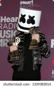 LOS ANGELES - MAR 14:  Marshmello, Christopher Comstock at the iHeart Radio Music Awards - Press Room at the Microsoft Theater on March 14, 2019 in Los Angeles, CA