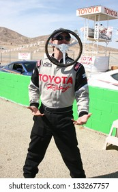 LOS ANGELES - MAR 23: Jackson Rathbone playing with a racing wheel at the 37th Annual Toyota Pro/Celebrity Race training at the Willow Springs International Speedway on March 23, 2013 in Rosamond, CA