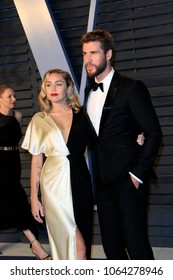 LOS ANGELES - MAR 4:  Miley Cyrus, Liam Hemsworth at the 24th Vanity Fair Oscar After-Party at the Wallis Annenberg Center for the Performing Arts on March 4, 2018 in Beverly Hills, CA