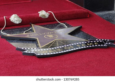 LOS ANGELES - MAR 7: James Franco star covered up at a ceremony as James Franco is honored with a star on the Hollywood Walk of Fame on March 7, 2013 in Los Angeles, California