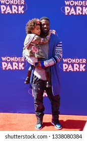 LOS ANGELES, March 10th, 2019: Actor Lance Gross and daughter, Berkeley Brynn Gross, attend the U.S. premiere of Wonder Park at the Regency Village Theatre in Westwood, California.