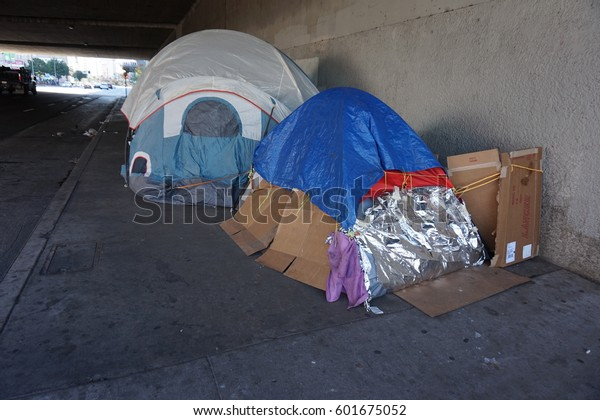 LOS ANGELES, MARCH 1ST, 2017: Close up of tents at a homeless encampment underneath a freeway overpass in downtown Los Angeles.