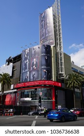 LOS ANGELES, MARCH 1ST, 2018: Cars are driving past a giant Oscar ad, featuring host Jimmy Kimmel, at the Hollywood and Highland intersection. The 90th Academy Awards will be held on March 4th.