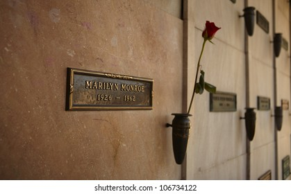 LOS ANGELES - MARCH 2: Marilyn Monroe's Crypt with a fresh red rose at Westwood Memorial Park on March 2, 2012. 2012 is the 50th anniversary of Monroe's death on 5th of August 1962.