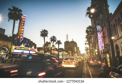 LOS ANGELES - MARCH 20, 2015: Hollywood Boulevard at sunset twilight with blurred cars light tracks - The Walk of Fame was created on 1958 as a tribute to artists working in the entertainment industry
