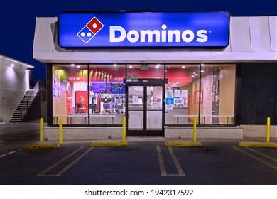 Los Angeles - March 20, 2021: Dominos Pizza illuminated store night exterior