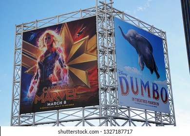 LOS ANGELES, March 2nd, 2019: Close up against a blue sky of a colorful billboard above the El Capitan theatre on Hollywood Boulevard, advertising the new Disney movies Captain Marvel and Dumbo.