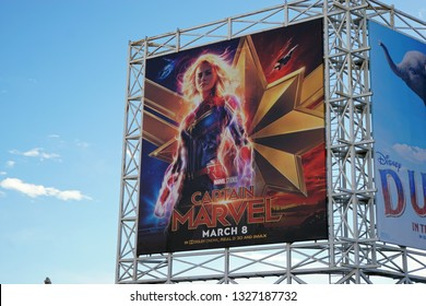 LOS ANGELES, March 2nd, 2019: Close up against a blue sky of a colorful billboard above the El Capitan theatre on Hollywood Boulevard, advertising the new Disney and Marvel movie Captain Marvel.