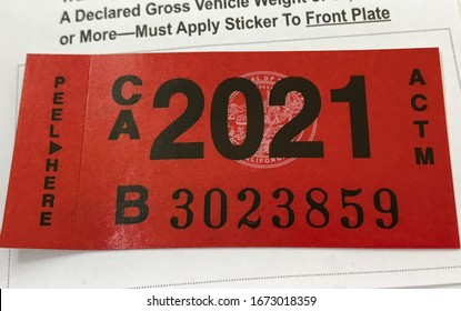 LOS ANGELES, March 5th, 2020: Department of Motor Vehicles DMV California registration tag sticker attached to renewal notice extreme close up.