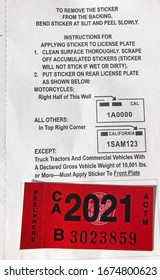 LOS ANGELES, March 5th, 2020: Department of Motor Vehicles DMV California registration tag sticker attached to renewal notice close up.