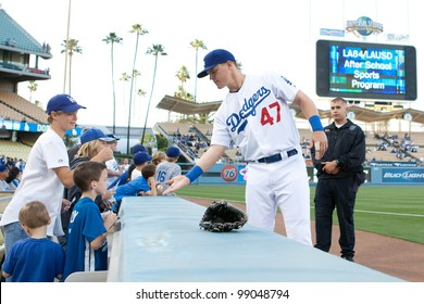 LOS ANGELES - MAY 13: Los Angeles Dodgers LF Jerry Sands #47 signs autographs for young fans before the MLB game between the Arizona Diamondbacks & Los Angeles Dodgers on May 13 2011 at Dodger Stadium
