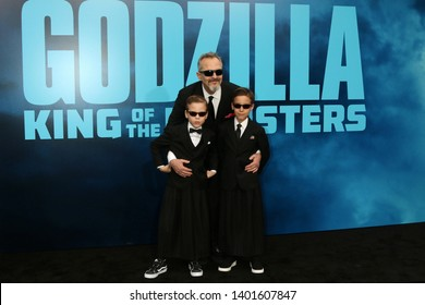 """LOS ANGELES - MAY 18:  Miguel Bose, Sons Diego and Tadeo at the """"Godzilla: King Of The Monsters"""" Premiere at the TCL Chinese Theater IMAX on May 18, 2019 in Los Angeles, CA"""