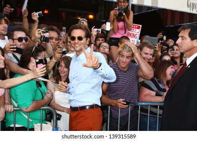 "LOS ANGELES - MAY 20:  Bradley Cooper interacts with fans at the ""Hangover III"" LA premiere at the Village Theater on May 20, 2013 in Westwood, CA"