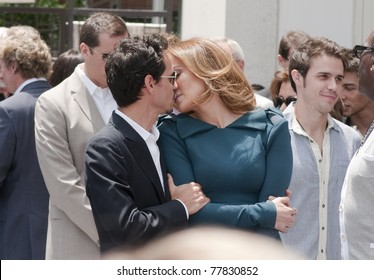 LOS ANGELES - MAY 23: Jennifer Lopez and Mark Antony kiss at Simon Fuller Hollywood Walk of Fame Star Ceremony at Hollywood Blvd on May 23, 2011 in Los Angeles, CA.