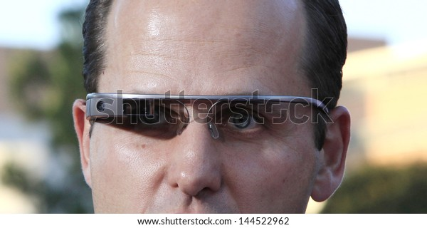 LOS ANGELES - MAY 29: A man is seen wearing Google Glass at the premiere of 'The Internship' at the Regency Village Westwood on May 29, 2013 in Los Angeles, California