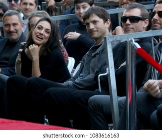 LOS ANGELES - MAY 3:  Mila Kunis, Ashton Kutcher, Sam Worthington at the Zoe Saldana Star Ceremony  on the Hollywood Walk of Fame on May 3, 2018 in Los Angeles, CA