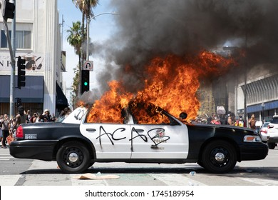 LOS ANGELES - MAY 30, 2020: Police Car Being Burned During Protest March Against Police Violence Over Death Of George Floyd.