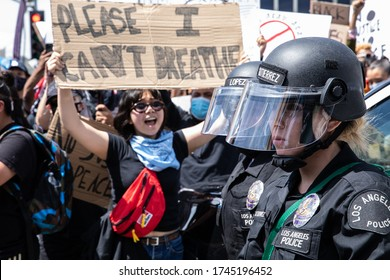LOS ANGELES - MAY 30, 2020: Unidentified Participants Confronting The Police During The Protest March Against Police Violence Over Death Of George Floyd.