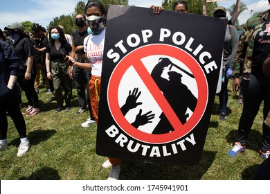 LOS ANGELES - MAY 30, 2020: Participant With Sign Saying Stop Police Brutality  At the Protest March Against Police Violence Over Death Of George Floyd.