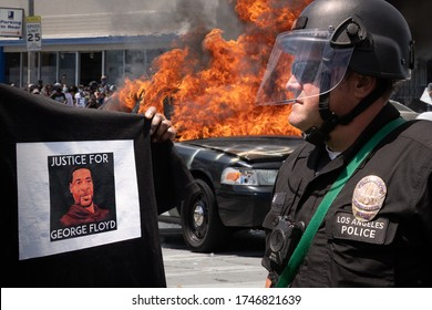 LOS ANGELES - MAY 30, 2020: Unidentified Participant Confronting The Police With A Shirt With Portrait Of George Floyd During The Protest March Against Police Violence Over Death Of George Floyd.