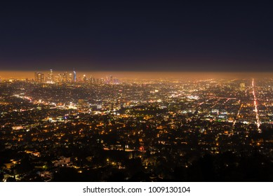 Los Angeles Night Cityscape, a Dark Shadow of Cloud & Smog Hangs over the City