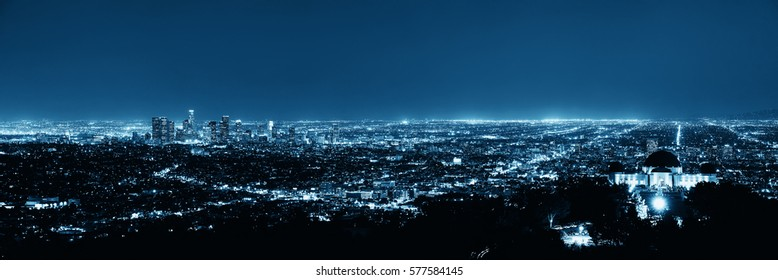 Los Angeles at night with urban buildings and Griffith Observatory