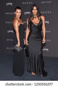 LOS ANGELES - NOV 03:  Kourtney Kardashian and Kim Kardashian arrives to the 2018 LACMA Art + Film Gala  on November 3, 2018 in Hollywood, CA