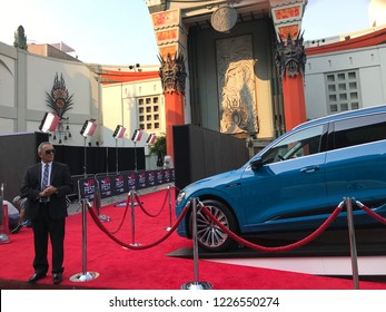 LOS ANGELES, Nov 10th,2018: An official in a black suit stands guard on the red carpet in front of the TCL Chinese Theatre, in preparations for a Gala screening, part of the AFI Film Fest in Hollywood
