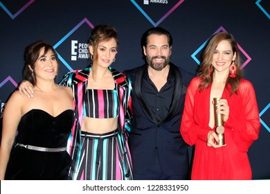 LOS ANGELES - NOV 11:  (L-R)- Emily Andras, Melanie Scrofano, Tim Rozon, Katherine Barrell at the People's Choice Awards 2018 at the Barker Hanger on November 11, 2018 in Santa Monica, CA
