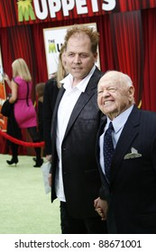 LOS ANGELES - NOV 12: Mickey Rooney and his son at the world premiere of 'The Muppets' held at the El Capitan Theater on November 12, 2011 in Los Angeles, California