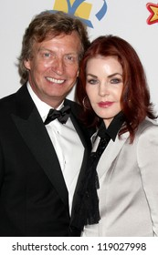 LOS ANGELES - NOV 16:  Nigel Lythgoe, Priscilla Presley arrive for the 11th Annual Celebration of Dreams at Bacara Resort & Spa on November 16, 2012 in Santa Barbara, CA