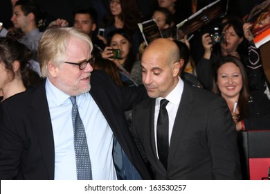 LOS ANGELES - NOV 18:  Phillip Seymour Hoffman, Stanley Tucci at the The Hunger Games:  Catching Fire Premiere at Nokia Theater on November 18, 2013 in Los Angeles, CA